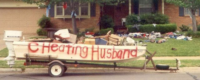 cheating husband written on boat