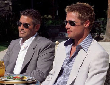 george clooney and brad pitt at a table