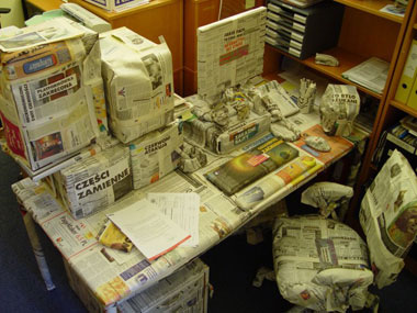 all office items wrapped in newspaper
