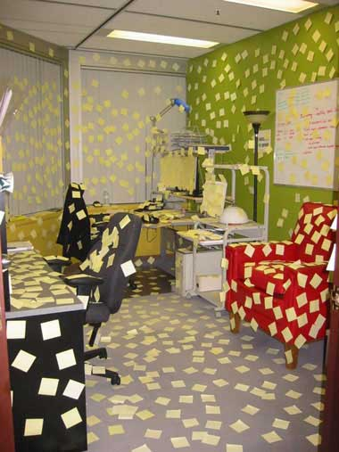 office covered with post it notes