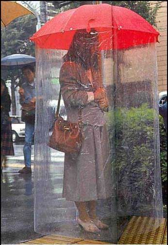 woman with umbrella and body length sheeting