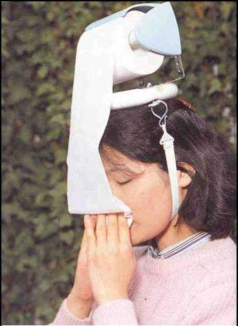 toilet roll attached to head
