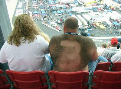 man with number three shaved into his back hair